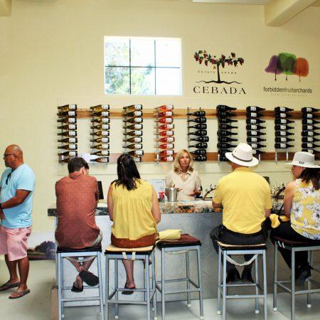 Customers enjoying wine inside Cebada tasting room